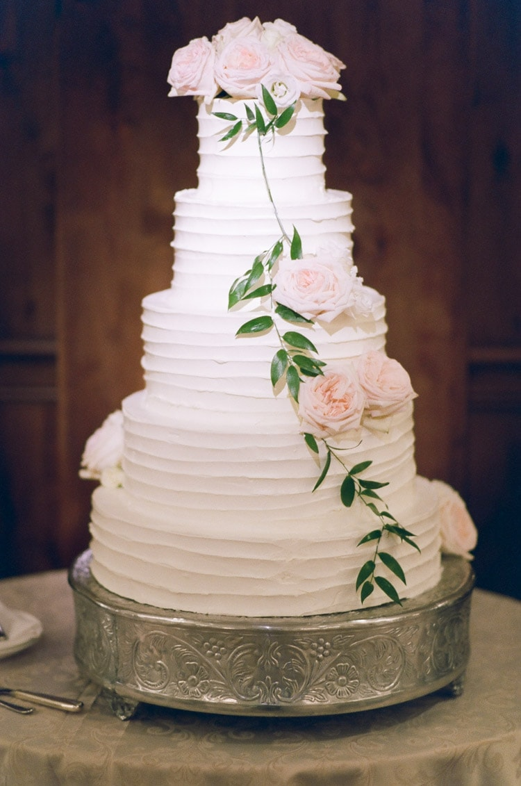 Huge cream white wedding cake with floral design pattern