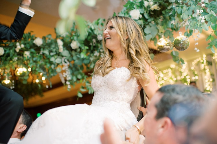 Bride lifted up in chair