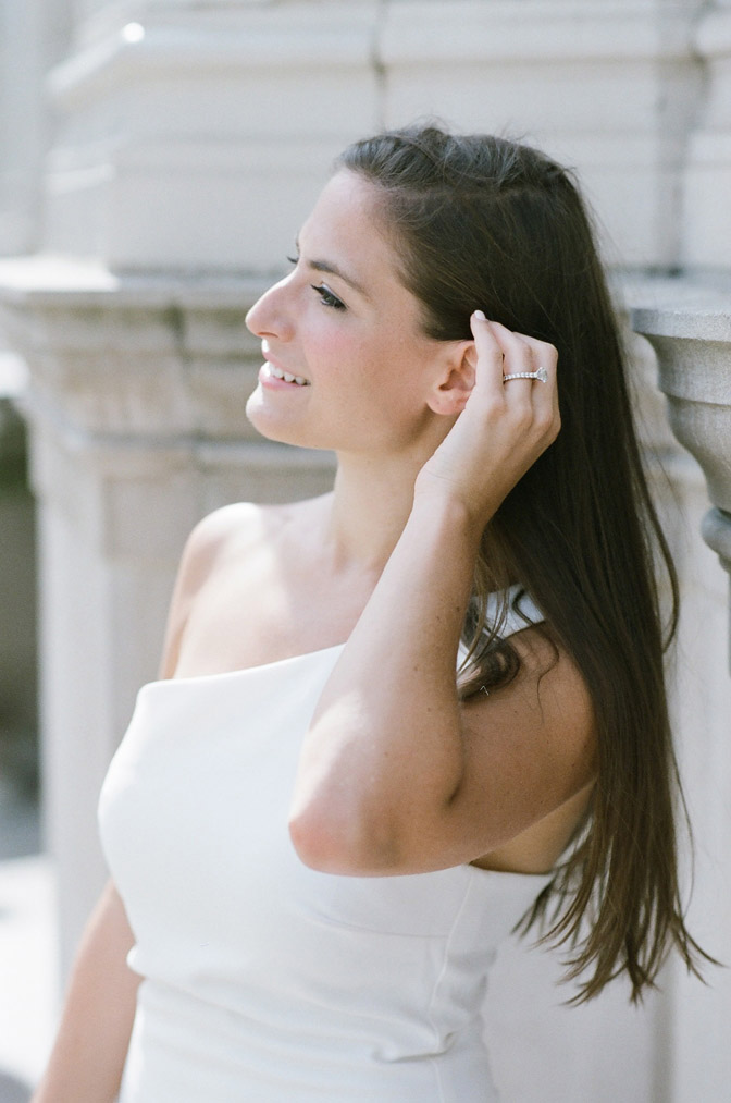 Bride tucking hair behind her ear during an engagement portrait session in Chicago