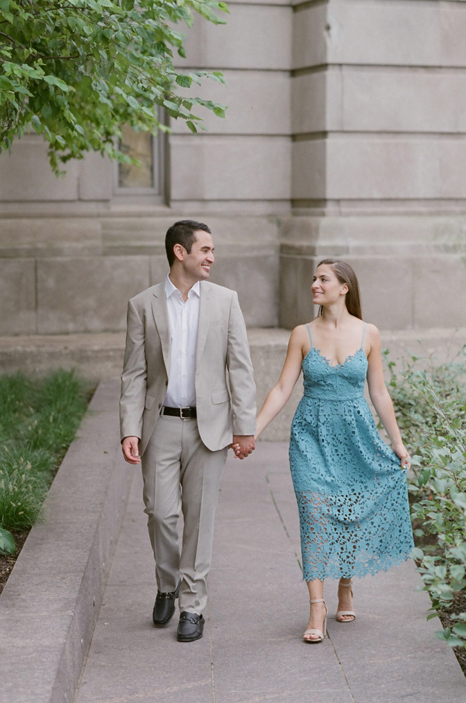 Couple holding hands during engagement portraits in Chicago