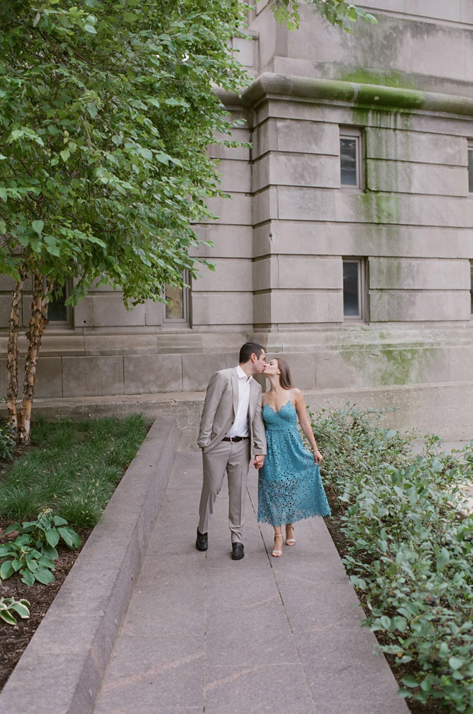 Bride and groom kissing during engagement portraits in Chicago