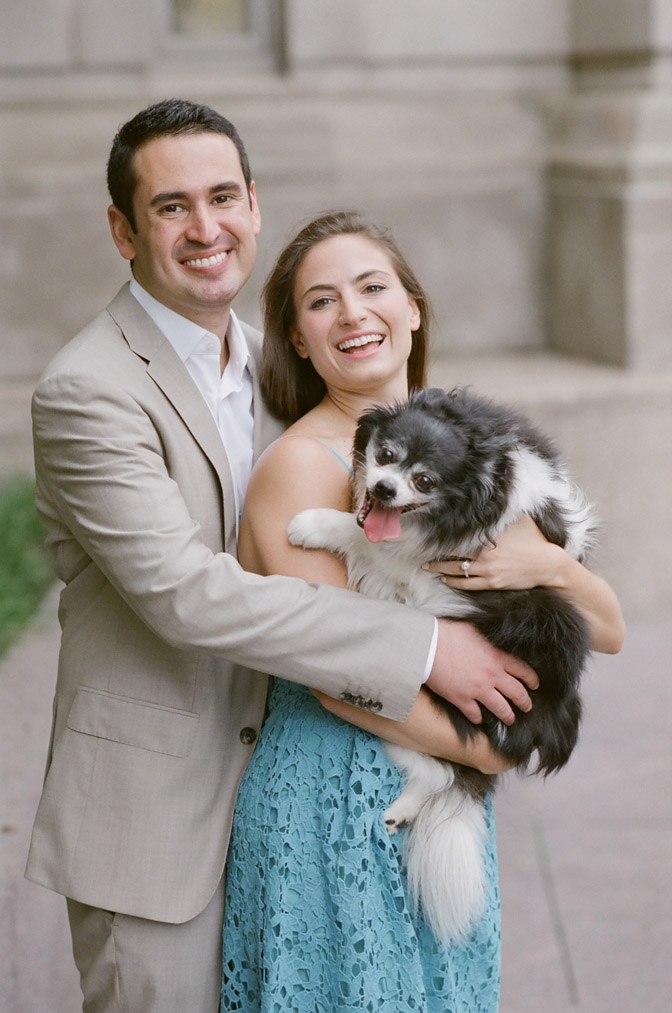 Bride and groom posing with their dog during engagement portraits in Chicago
