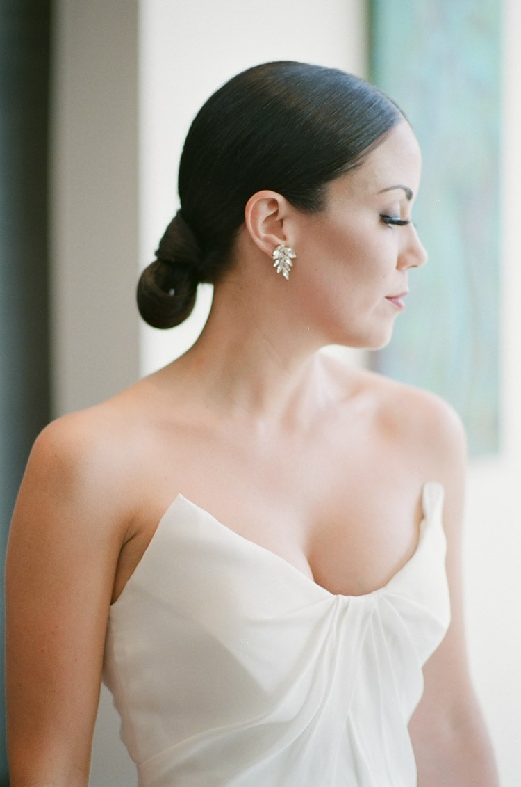 Portrait session of bride in white wedding dress