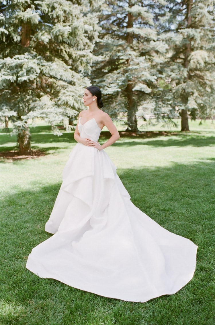Side view of bride posing on grass