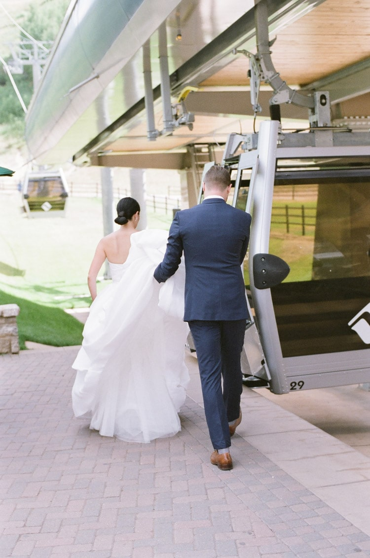 Bridal couple walking towards gondola lift
