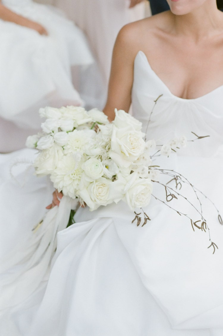 Large white rose bouquet held by bride