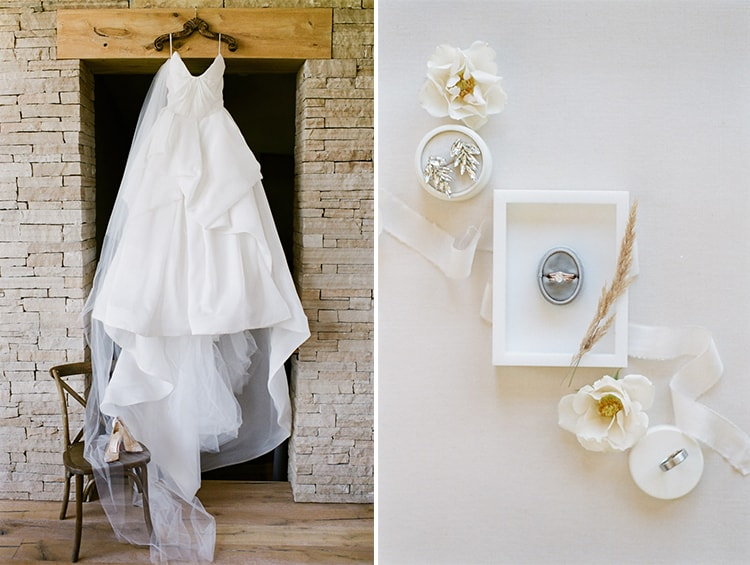 Hanged up white Monique Lhuillier gown and styled shot of wedding ring