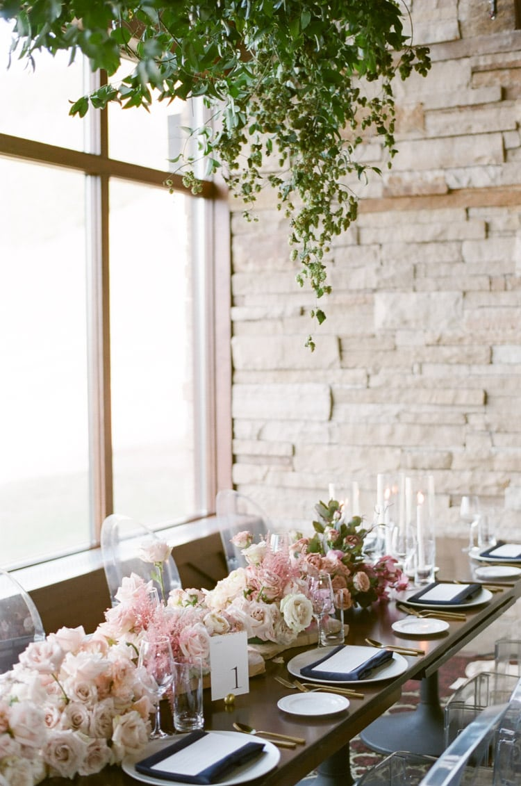 Floral arrangements in white and blush pink as table centerpieces