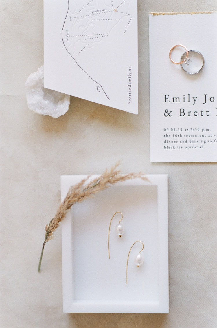 Closeup of wedding earrings and bands