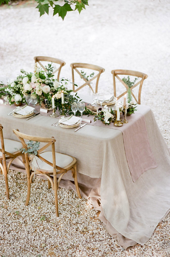Provencal wedding dinner table with natural elements reflecting colors of Provence