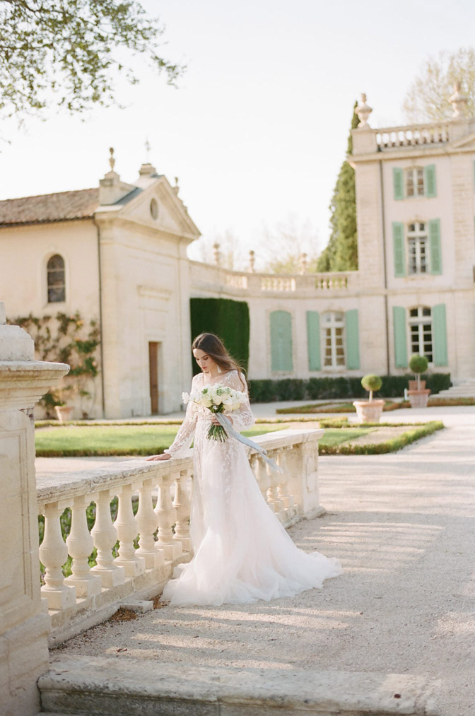 Wedding session of bride posing in front of French building