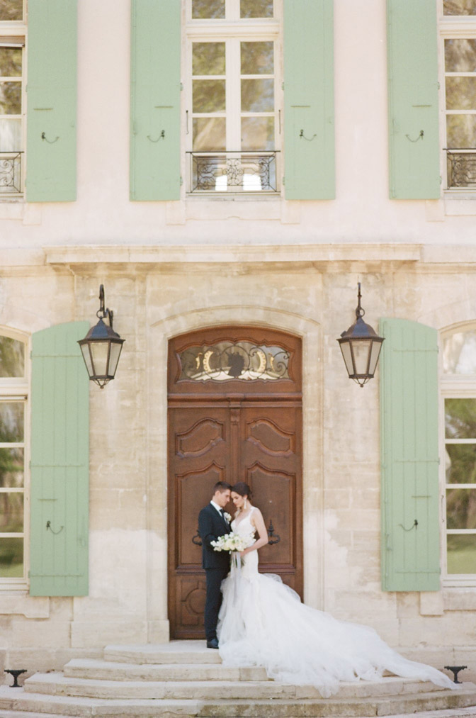 Wedding couple in front of large wooden door