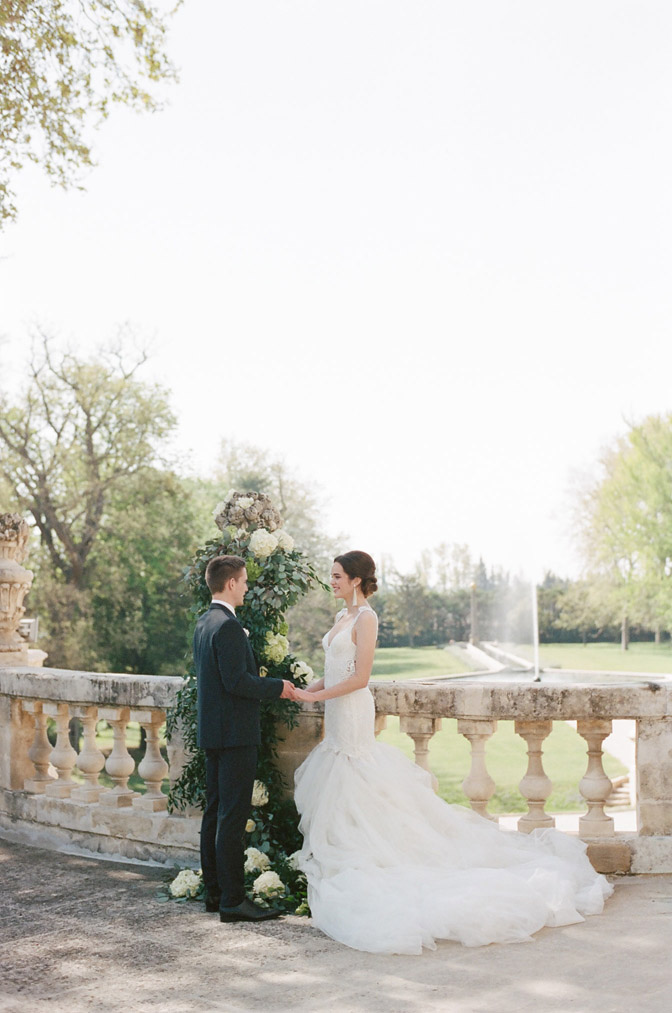 Intimate French wedding with backdrop of landscape over railing