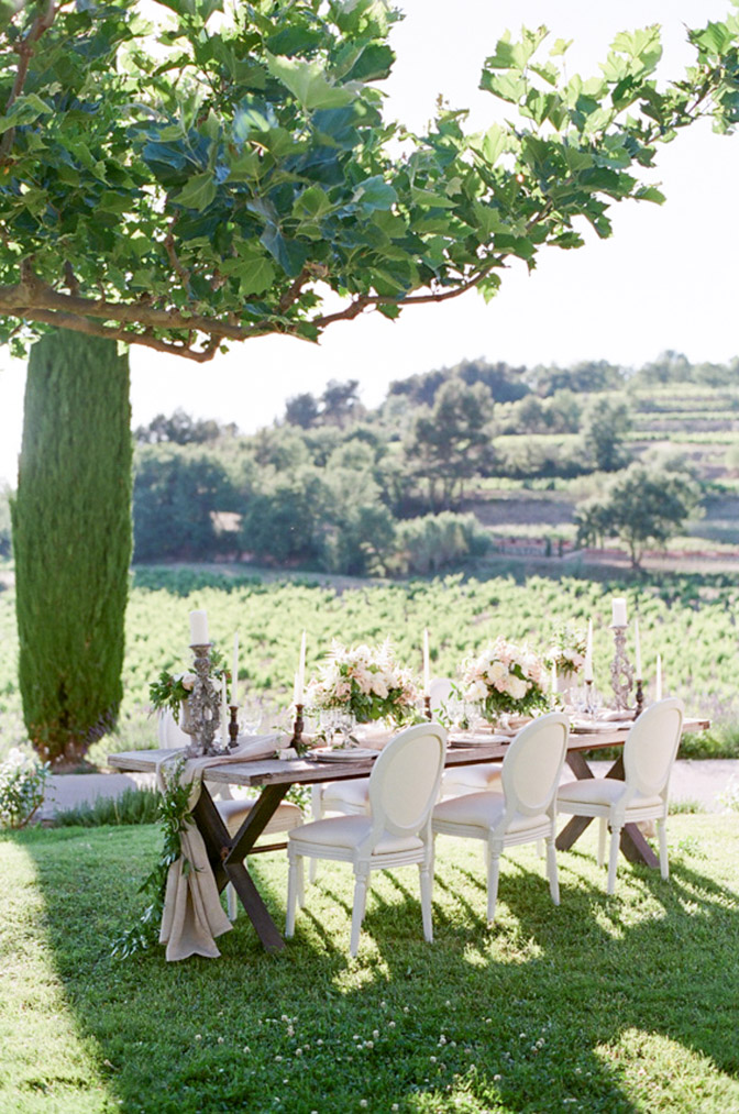 Wedding table outside with a view of the French landscape
