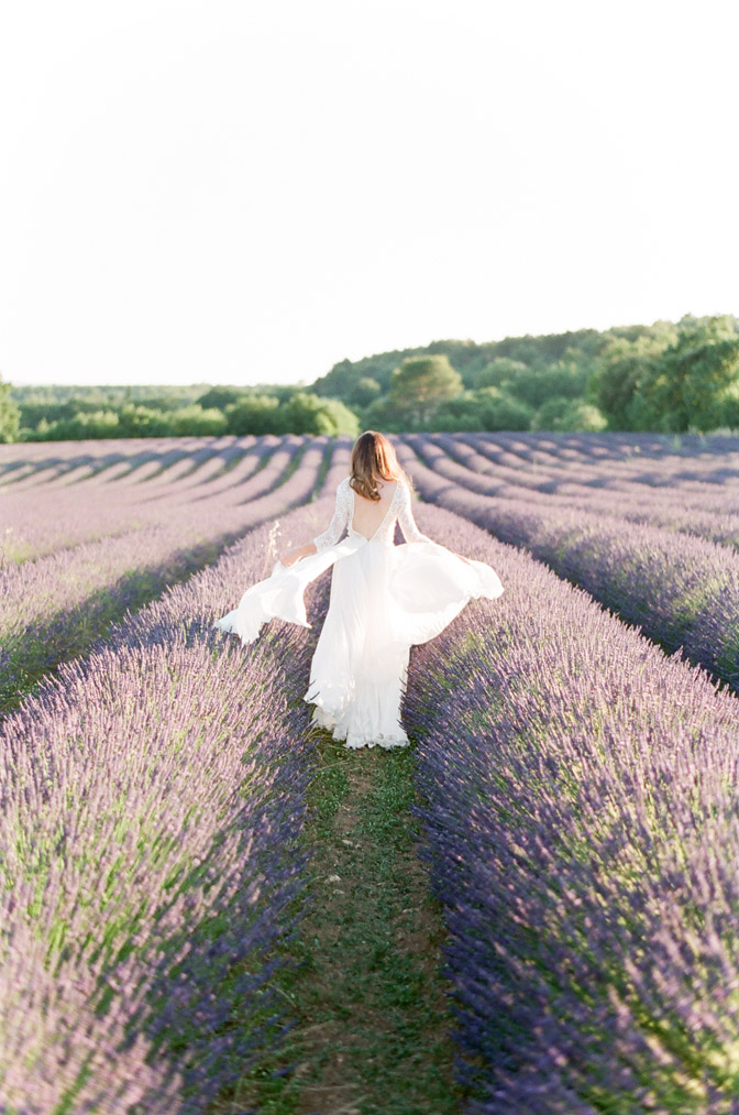 Session of bride in white dress in lavender field