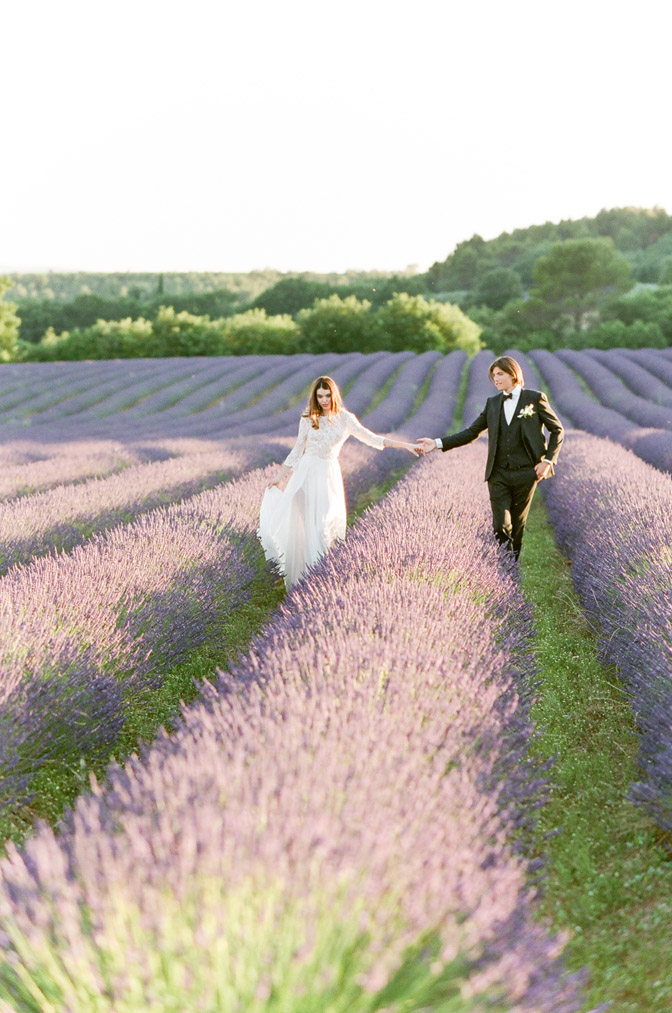 Couple holding hands at lavender fields in France