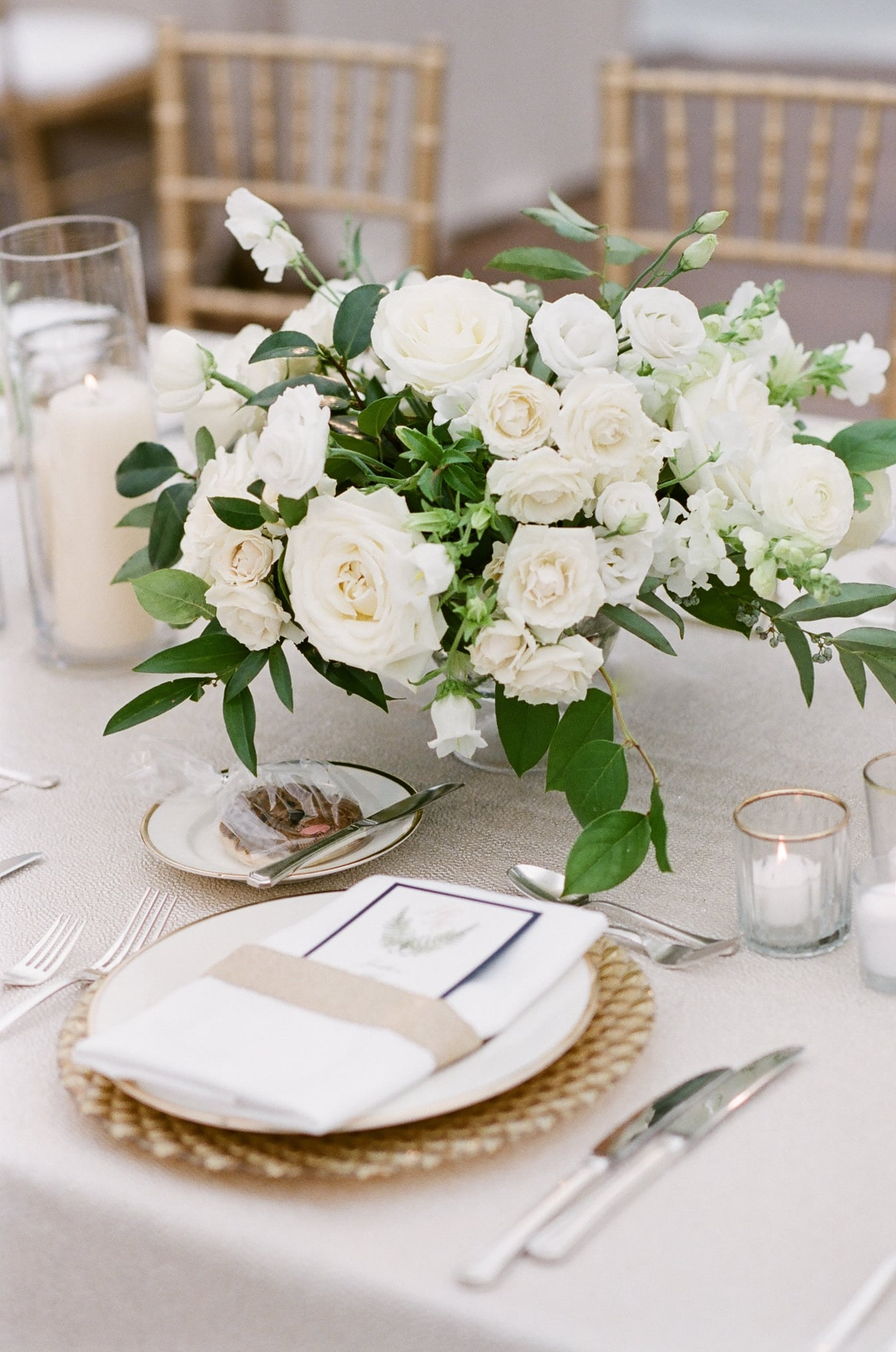 White floral centerpiece by Life in Bloom on table