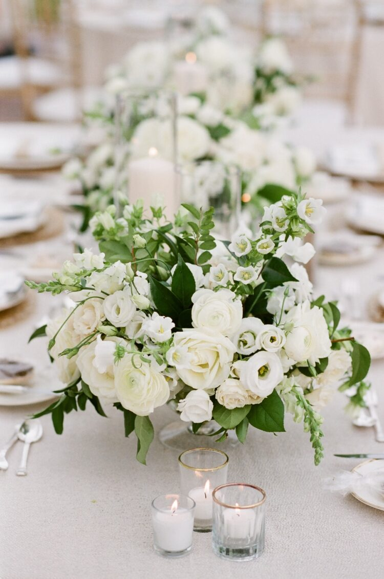 Floral centerpiece with greenery and candles