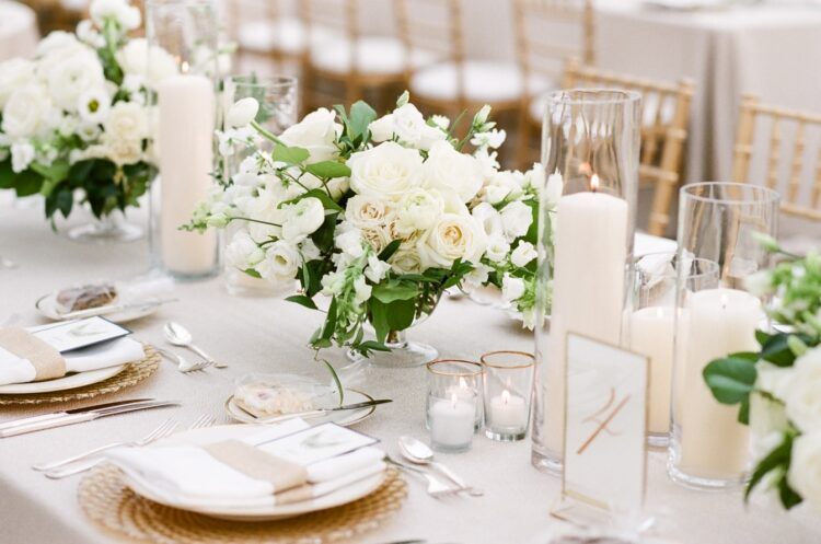 Lots of candles with floral designs and table decorations to create sophisticated theme