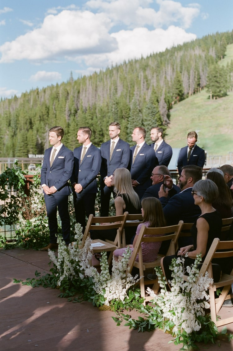Groomsmen standing in line during a wedding ceremony in Vail