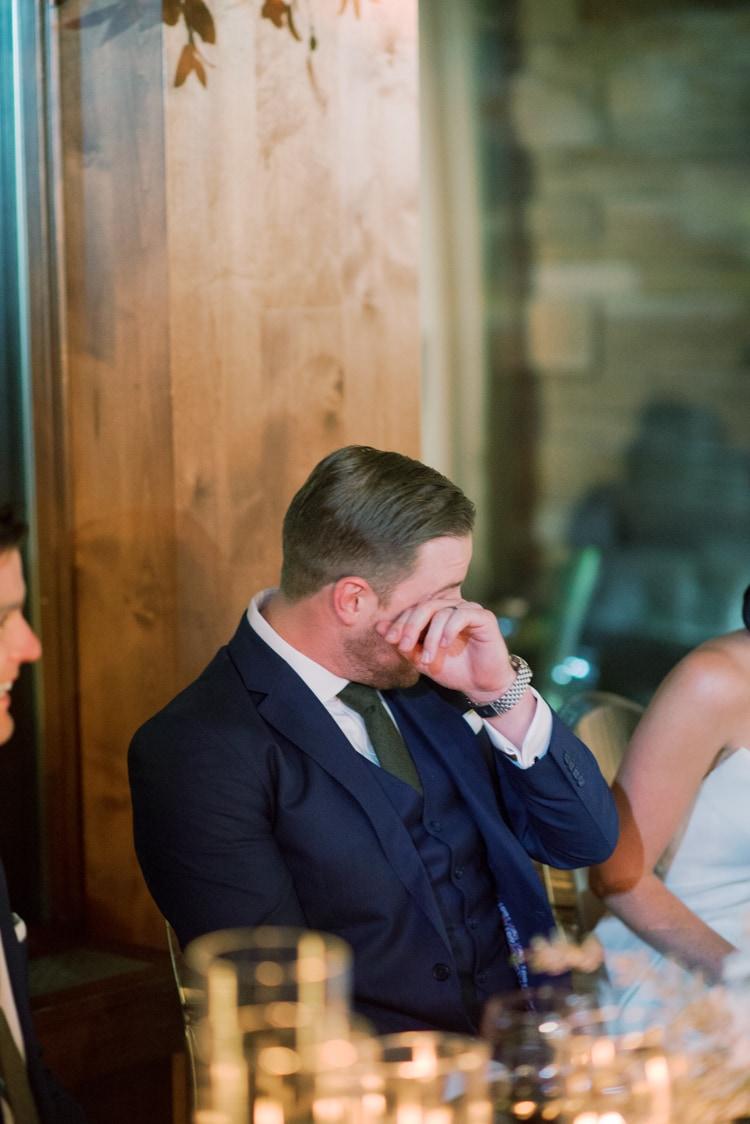 Groom crying during wedding reception in Colorado