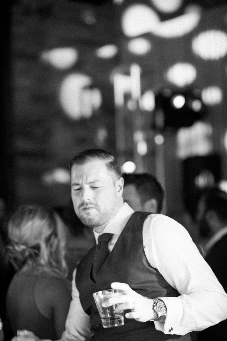 Groom dancing with a glass of whiskey