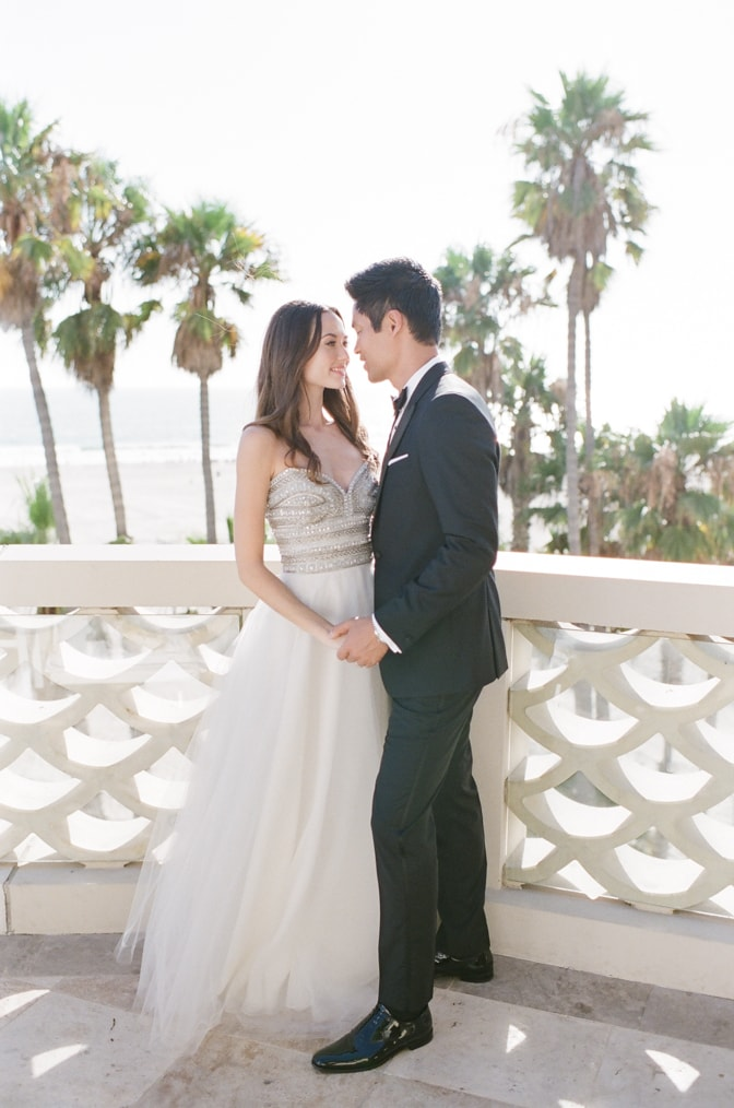 Bride and groom holding each others hand at Casa del Mar in Santa Monica for California wedding photographer Tamara Gruner