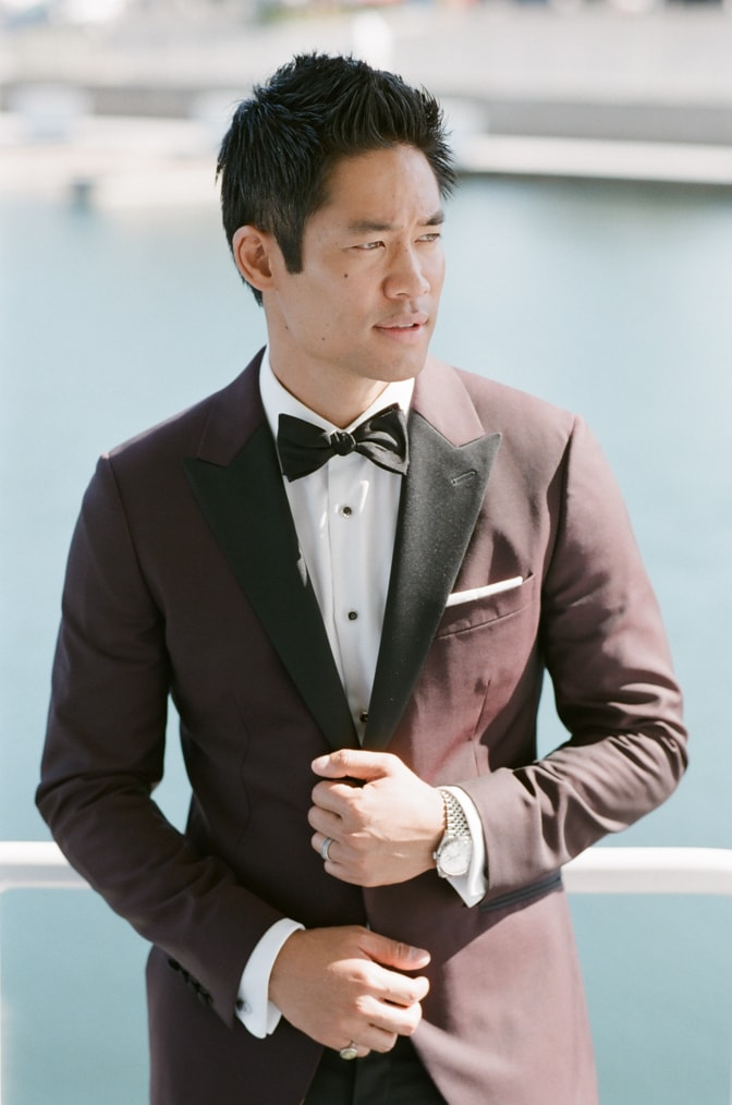 S.W.A.T. actor David Bradley Lim posing in his wedding suit in Santa Monica for California wedding photographer Tamara Gruner