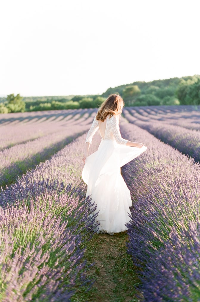 Bride dancing in the lavender fields of Provence in France
