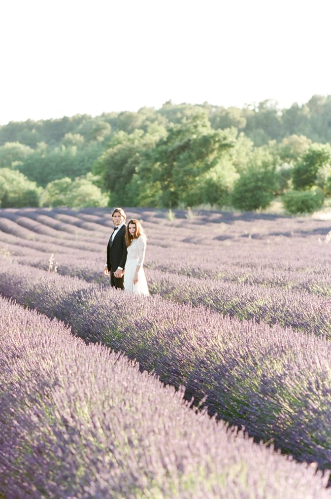 Bride and Groom holding hands in the lavender fields of the Luberon in Provence in France
