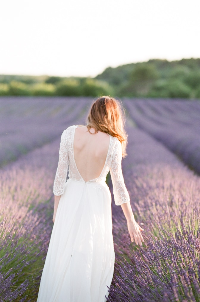 Bride touching lavender in the Luberon in Provence