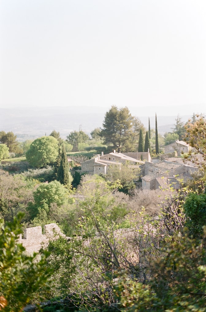 Oppède le Vieux village from afar photographed by luxury destination wedding photographer Tamara Gruner