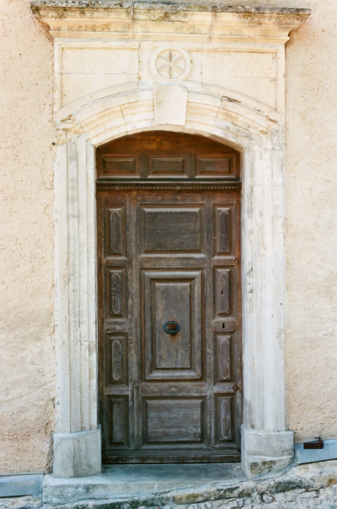 An old ornamental door at Oppède le Vieux in Provence, France