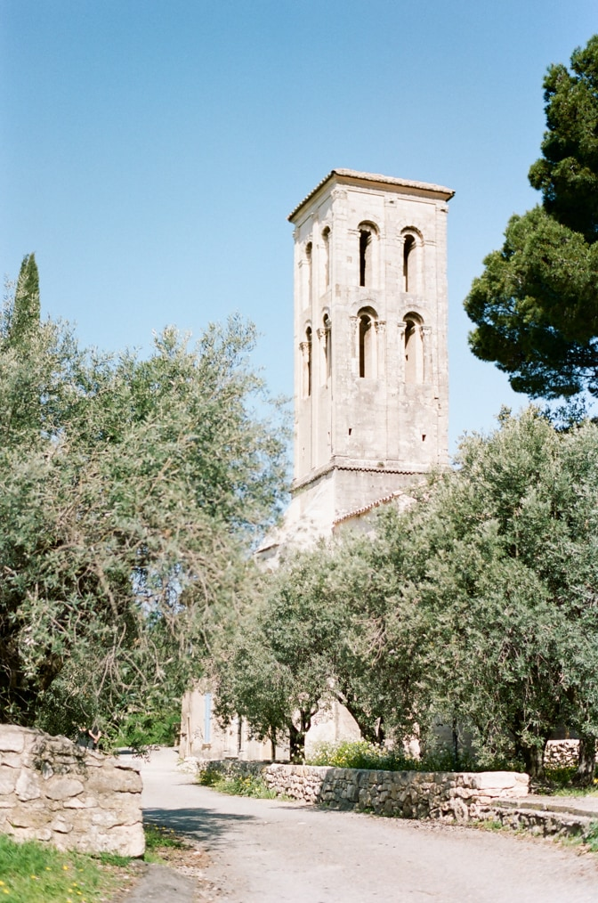 Venasque's church tower in Provence photographed by luxury destination wedding photographer Tamara Gruner