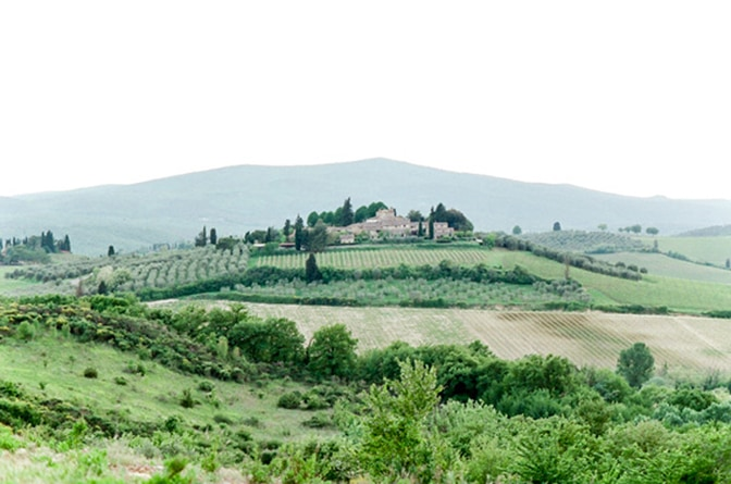 Tuscany's landscape with cypresses and small village