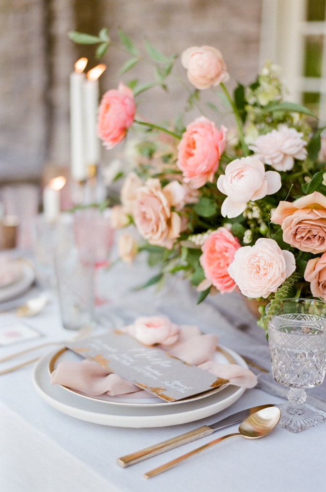 Close up of a luxurious wedding reception centerpiece with garden roses