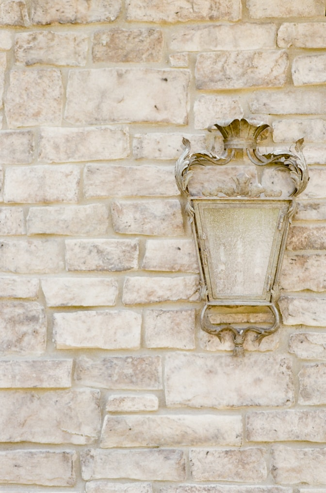 French-Inspired lantern on the stone wall of Castle Cliff Estate
