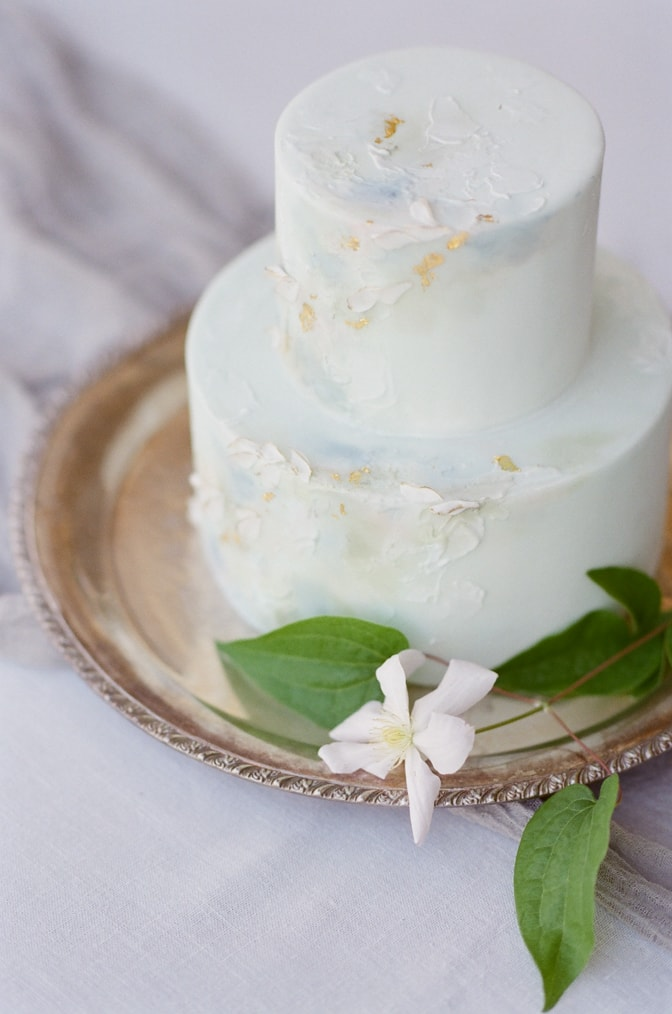 Closeup of a luxurious soft blue wedding cake in marble style