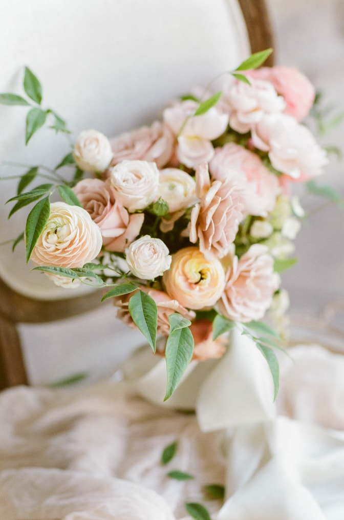 Closeup of a luxurious wedding bouquet made out of blush and peach garden roses
