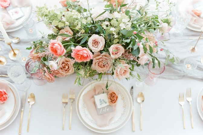 Luxurious wedding reception centerpiece with blush and pink garden roses