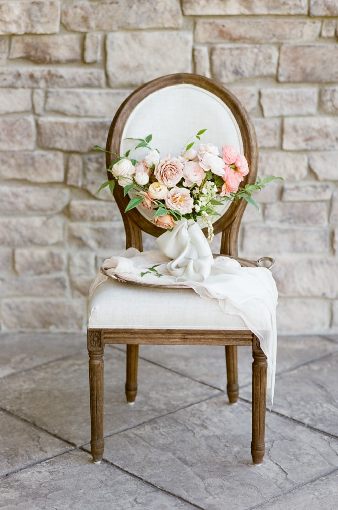 Luxurious wedding bouquet on top of a French chair