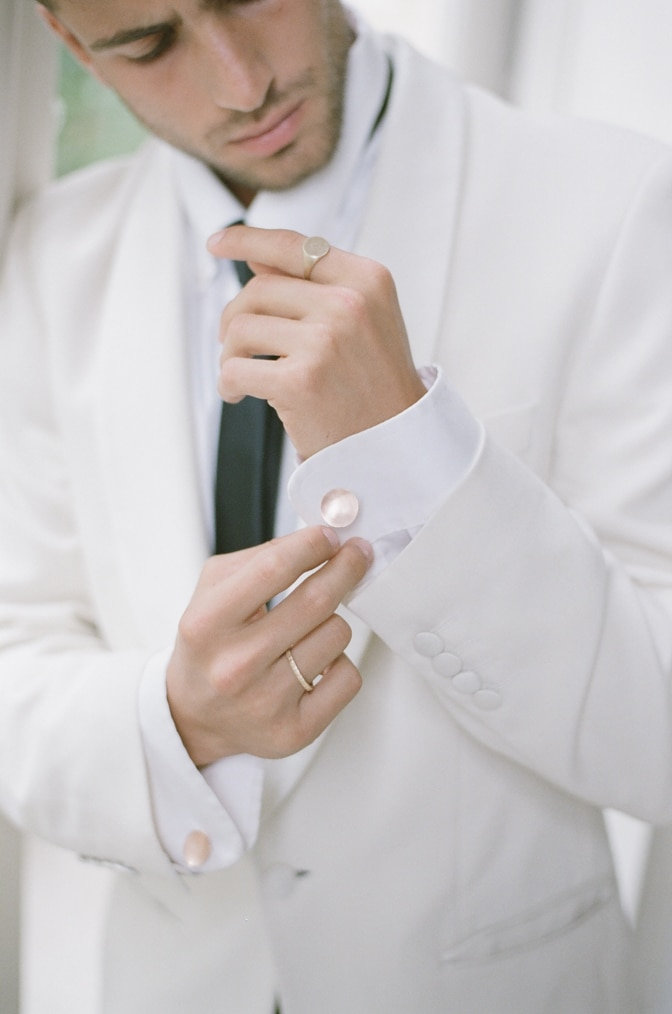 A styling guide for the modern groom showcasing gold cufflinks