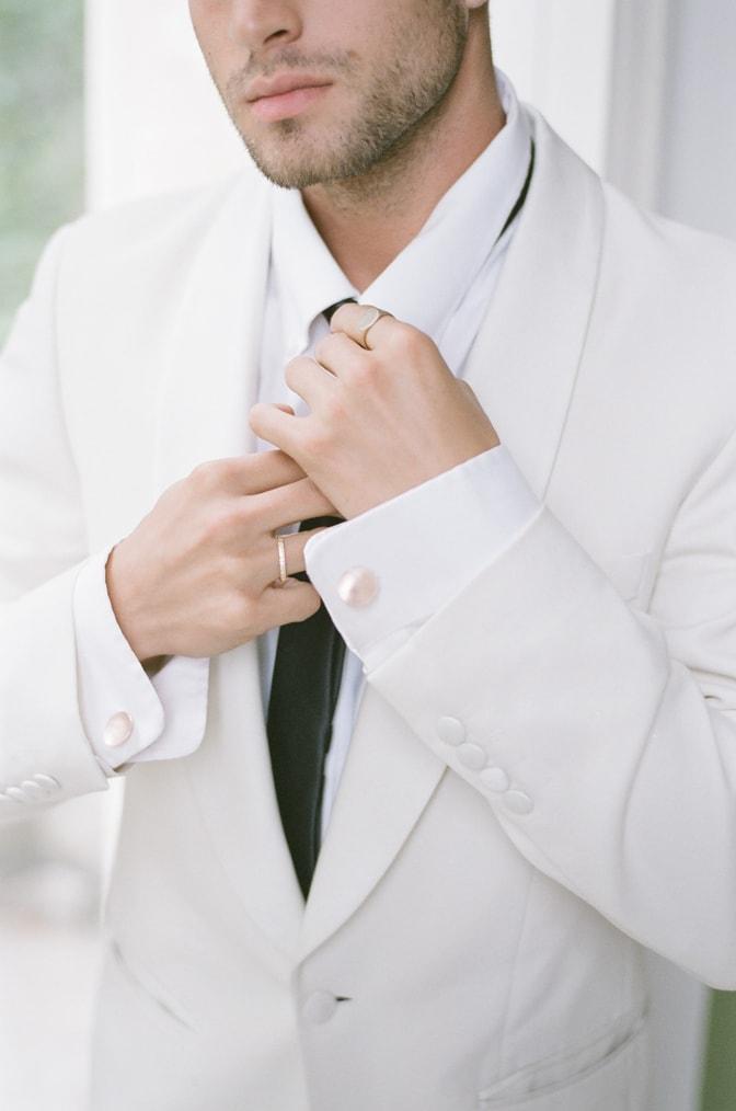 Closeup of groom's gold wedding band