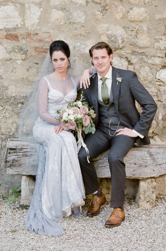 a style guide for the modern groom showing a groom in his grey suit and a green tie