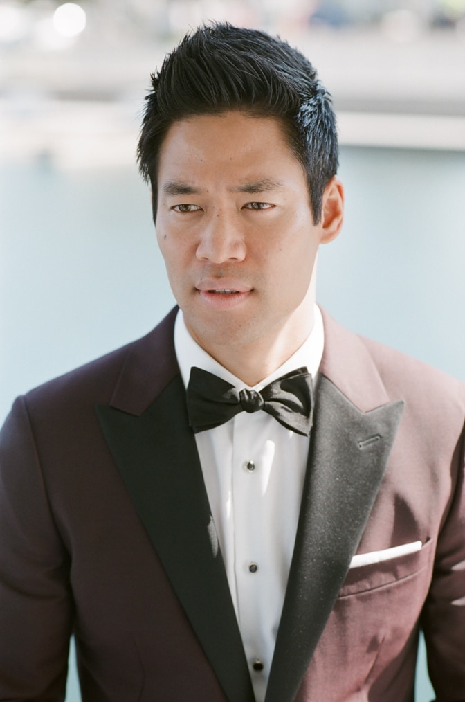 A style guide for the modern groom showcasing The SWAT actor David Bradley Lim in his burgundy jacket