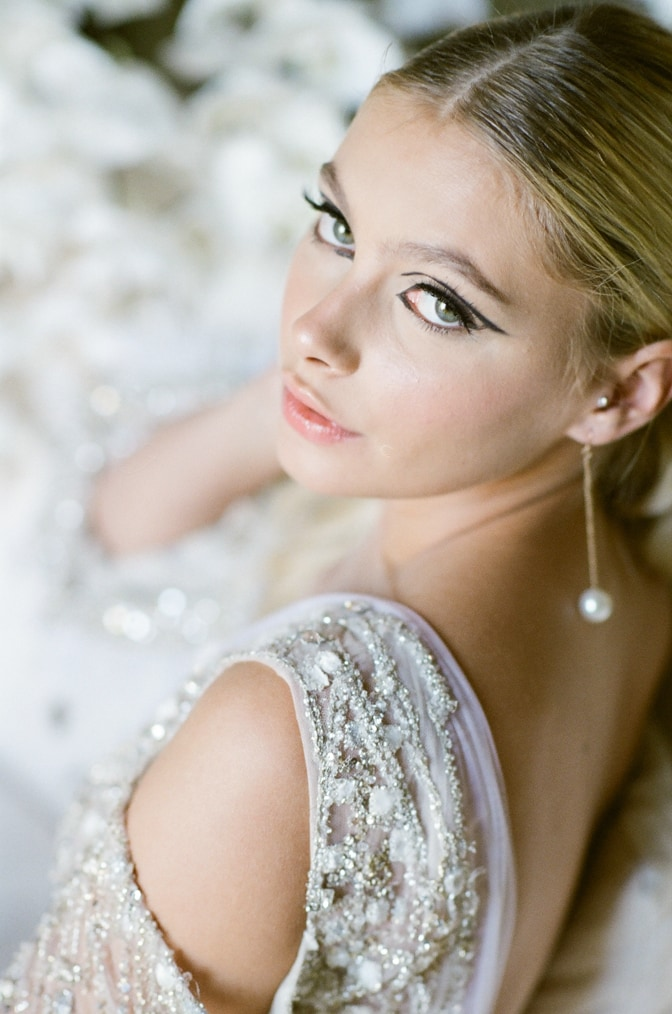 Bride sitting on a chaise and looking up for Provence Wedding Photographer Tamara Gruner