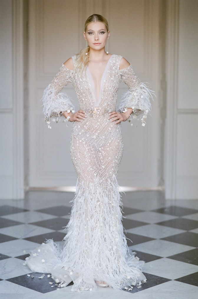 Bride in her Ziad Nakad gown standing in the hallway of Chateau Martinay