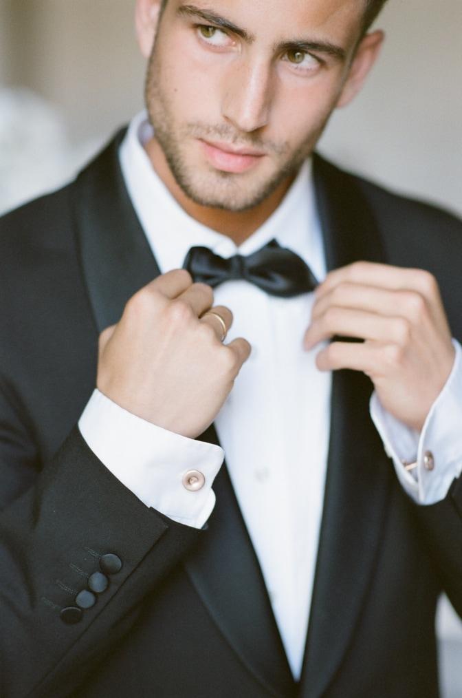 Groom fixing her bow tie for French Wedding Photographer Tamara Gruner