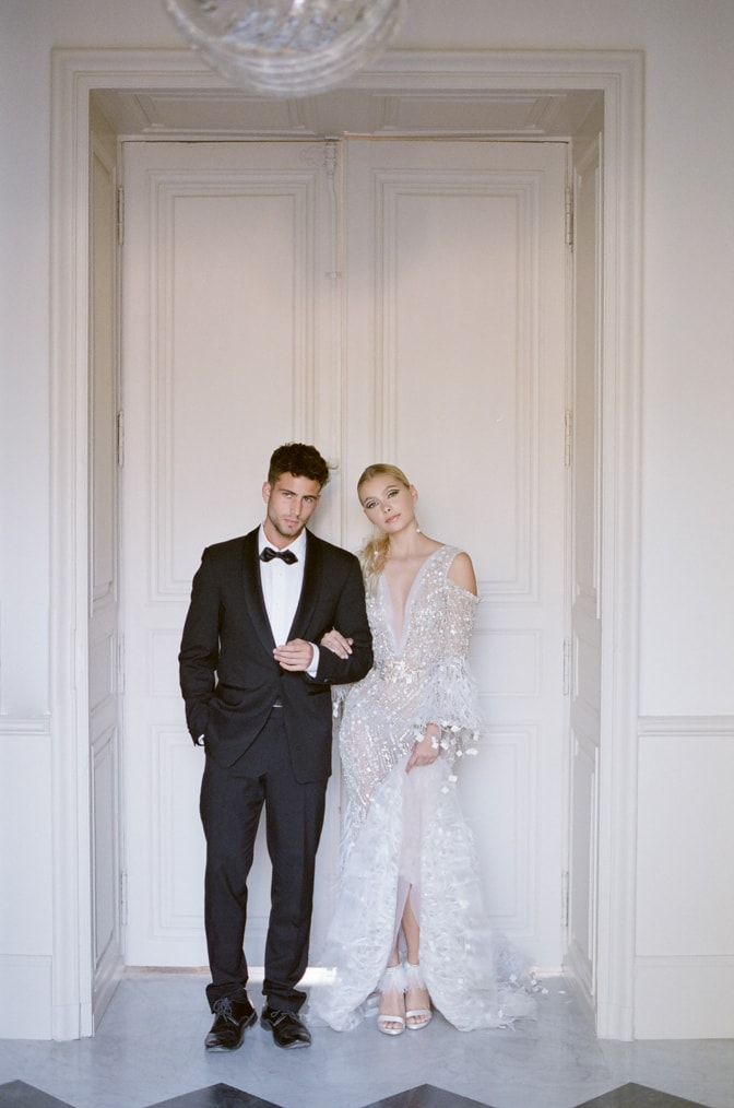 Bride and Groom in front of Chateau door during their French elopement