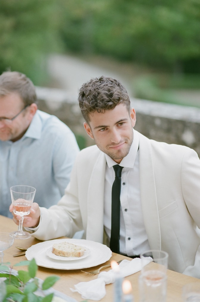 Groom cheering with his guests at Chateau Martinay